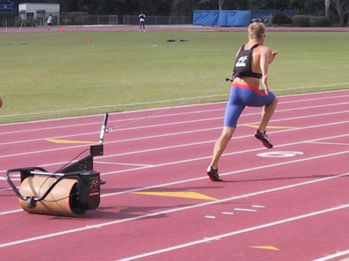 University of Florida - Power Pull Training - This athlete is in proper pulling form see the stright line in his form -  from ankle, knee, hip and shoulder with the forward lean